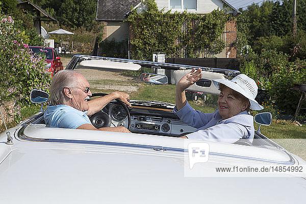 Senior couple in a car.