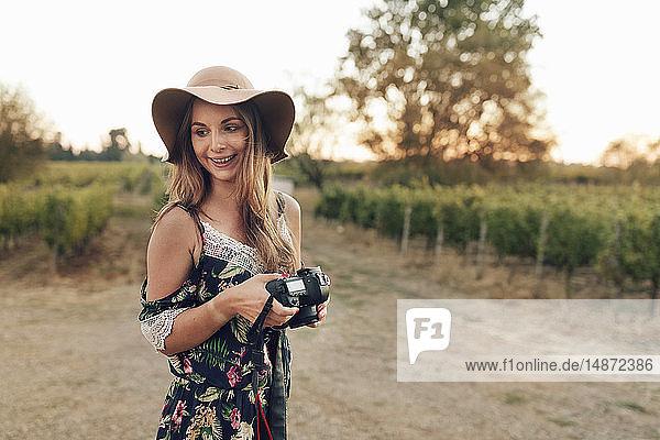 Smiling woman at vineyard