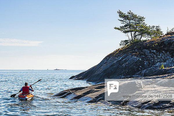 Man kayaking on sea