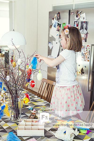 Girl decorating for Easter