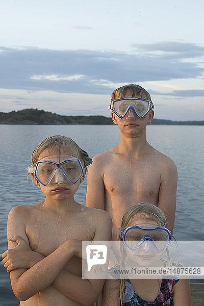 Three children wearing scuba mask