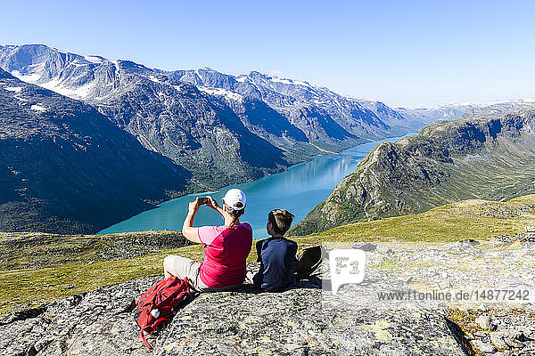 Hikers at lake taking picture