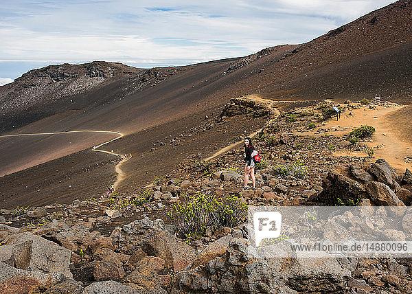 Hiker on hiking trail  Haleakala National Park  Maui  Hawaii