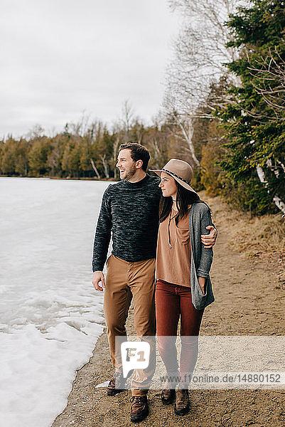 Couple walking along edge of snow field  Tobermory  Canada