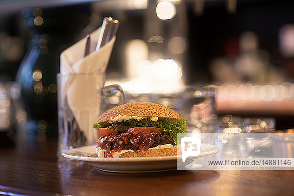 Plate of burger ready on pub counter top