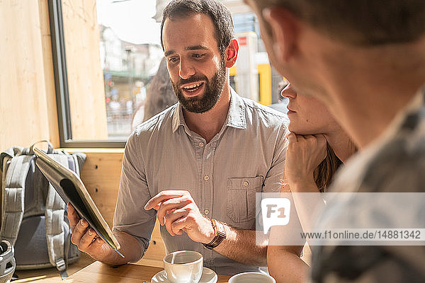 Group of entrepreneurs meeting with coffee and digital tablet
