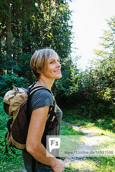 Woman exploring forest  Sonthofen  Bayern  Germany