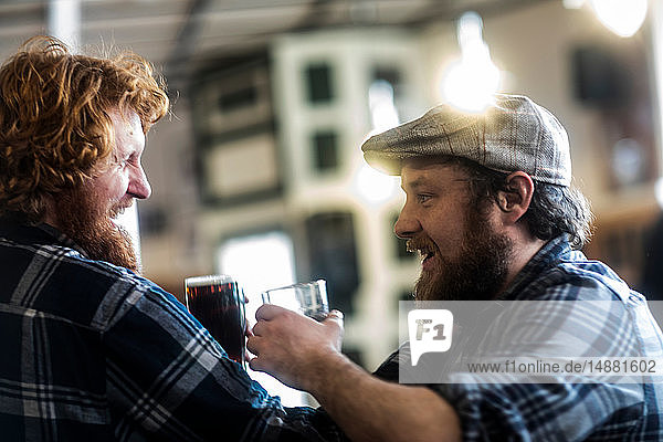 Male customers laughing in traditional Irish public house