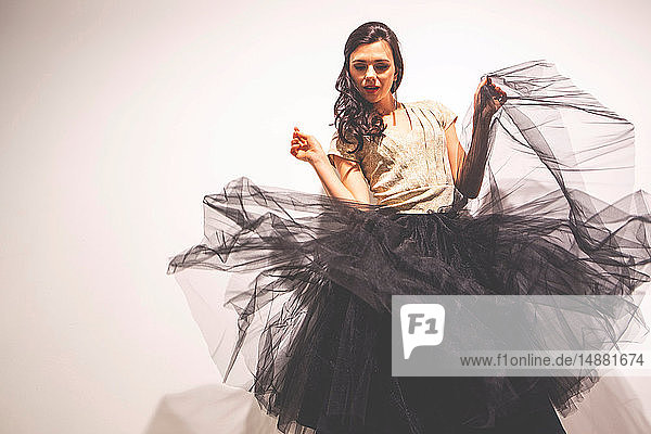 Woman holding tulle skirt dancing