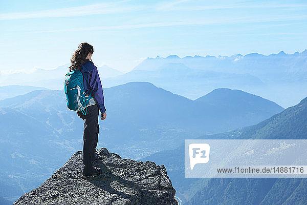 Mountain climber at summit  Chamonix  Rhone-Alps  France