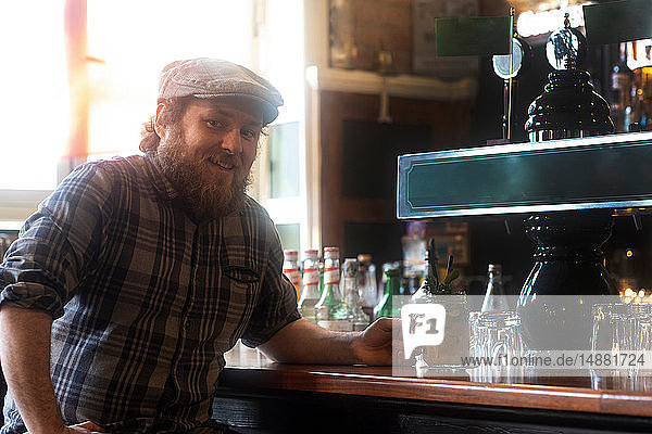 Male customers at bar in traditional Irish public house  portrait