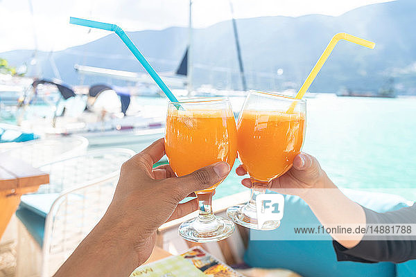 Couple toasting with cocktail on boat  Lefkada Island  Levkas  Greece