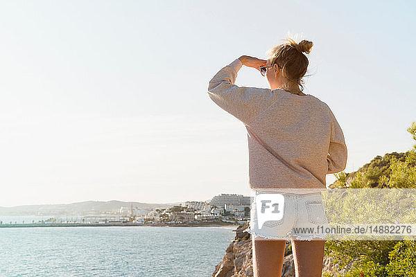 Woman enjoying view of sea  Sitges  Catalonia  Spain