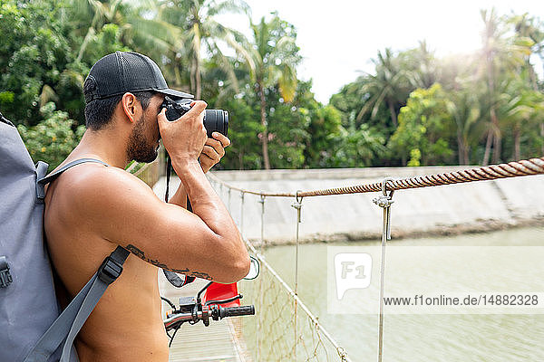Man photographing on rope bridge  Pagudpud  Ilocos Norte  Philippines