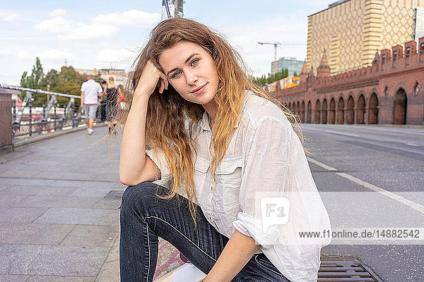 Young woman resting on Oberbaum bridge in city  Berlin  Germany