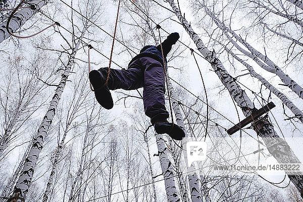 Man walking on rope bridge  Ural  Sverdlovsk  Russia