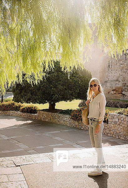 Woman walking in park  Tarragona  Catalonia  Spain