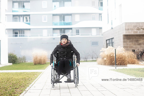 Woman in wheelchair in residential area