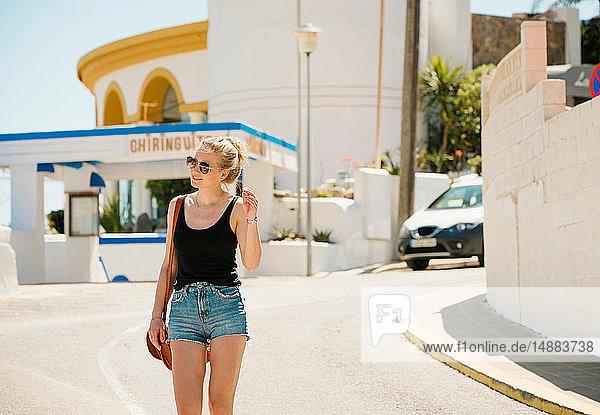 Woman exploring town  Garraf  Catalonia  Spain