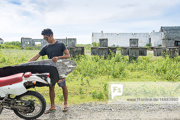 Motorcyclist with surfboard  Abulug  Cagayan  Philippines