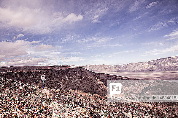 Man looking out over bleak arid landscape  Death Valley Junction  California  USA