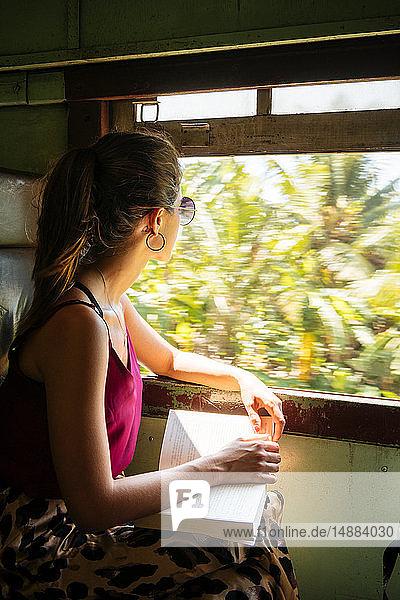 Woman on local train  Galle  South Coast  Sri Lanka