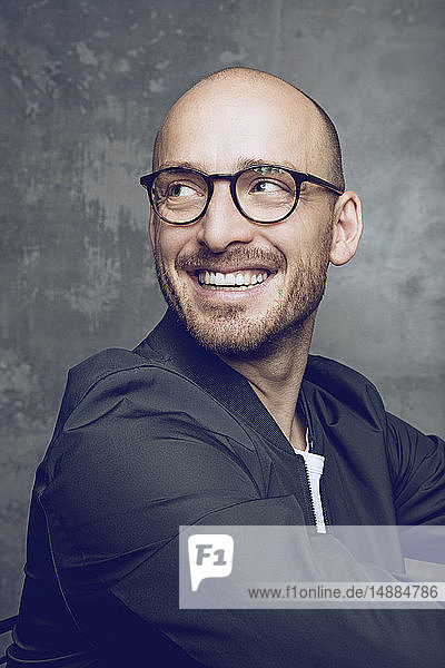 Portrait of a laughing man with glasses