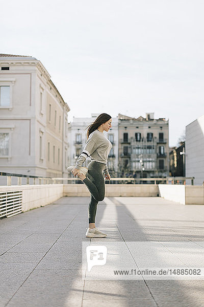 Young woman doing workout on terrace