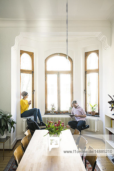 Couple relaxing in stylish apartment