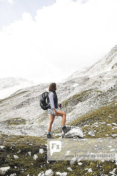 Austria  Tyrol  woman on a hiking trip in the mountains