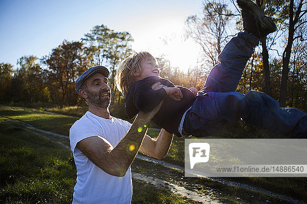 Father playing with his little son outdoors