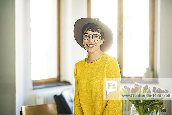 Portrait of happy stylish woman at home