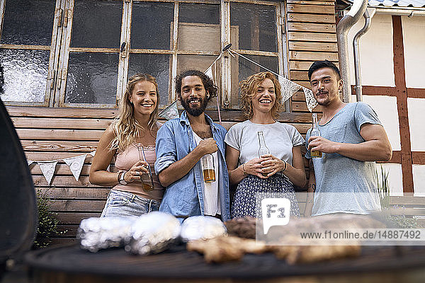 Freinds having fun at a barbecue party  drinking beer
