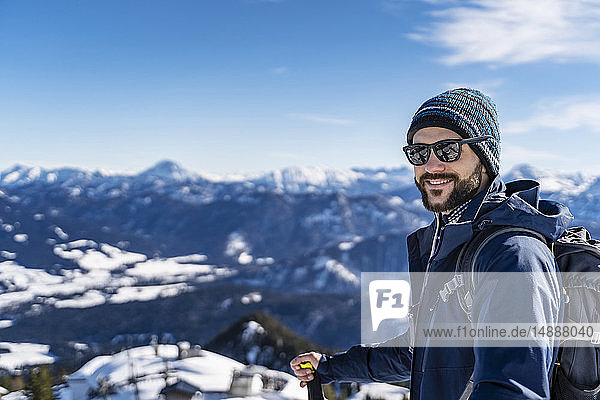 Germany  Bavaria  Brauneck  portrait of smiling man on a ski tour in winter in the mountains