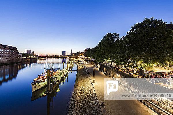 Germany  Free Hanseatic City of Bremen  Schlachte  Weser  riverside  promenade  boats  beer garden  restaurants  dusk