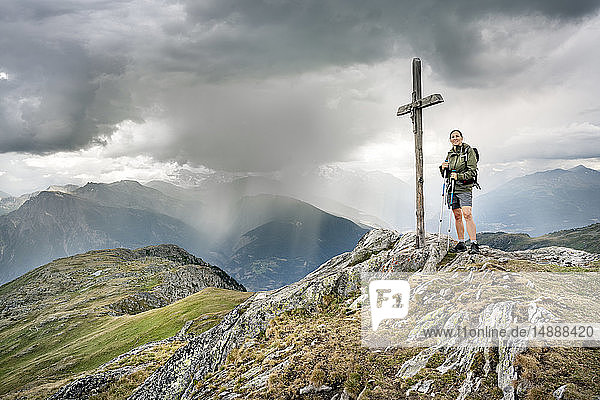Switzerland  Valais  woman on a hiking trip in the mountains at Foggenhorn summit