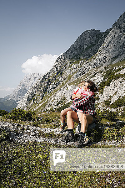 Austria  Tyrol  happy mother and daughter hugging in mountainscape