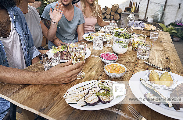 Friends having fun at a barbecue party  eating together