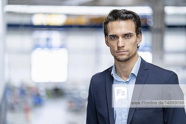 Portrait of confident businessman in a factory