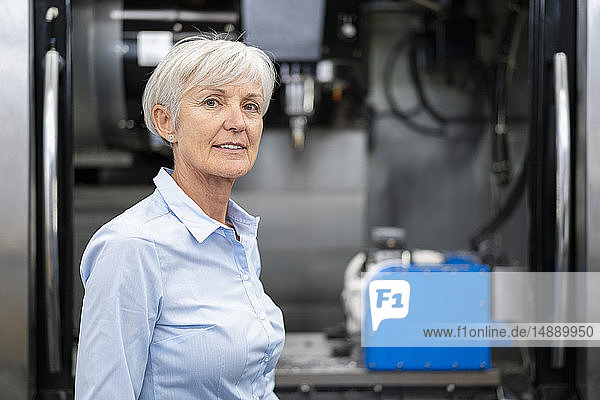Portrait of confident senior businesswoman in a factory