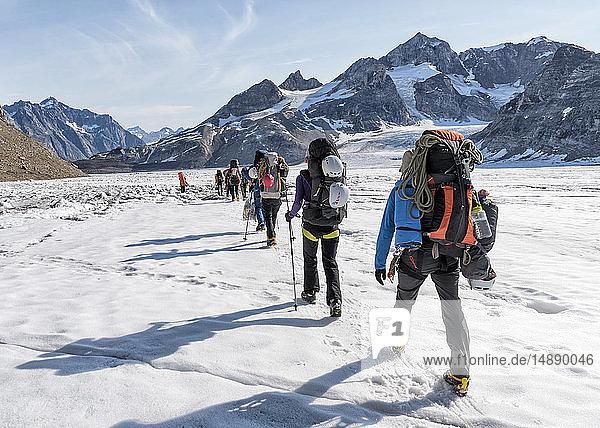 Greenland  Sermersooq  Kulusuk  Schweizerland Alps  group of people walking in snow