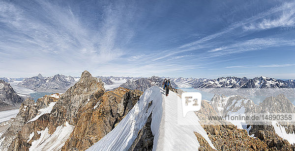 Greenland  Sermersooq  Kulusuk  Schweizerland Alps  mountaineers walking in snowy mountainscape