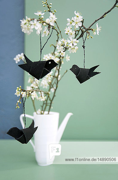 Easter decoration  Twig of sloe  leather cord folded as birds
