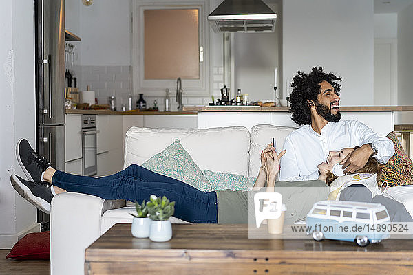 Couple relaxing on couch  planning their road trip
