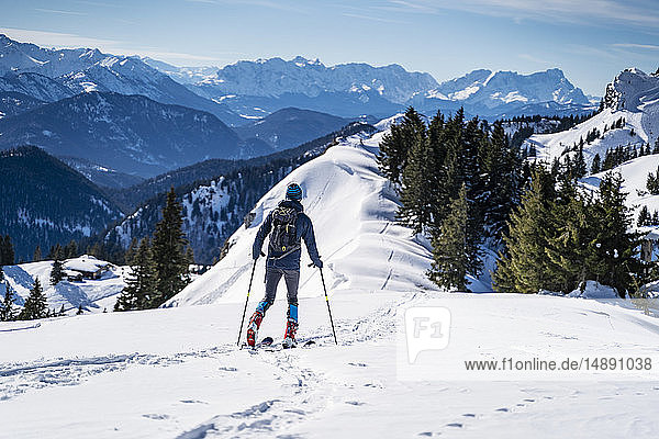 Germany  Bavaria  Brauneck  man on a ski tour in winter in the mountains