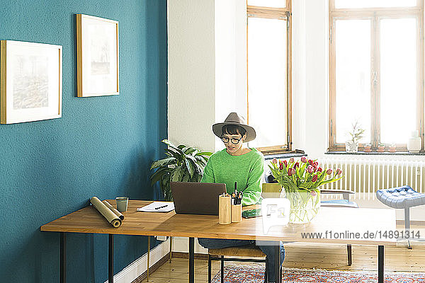 Businesswoman in home office working at her laptop