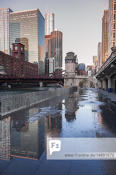 Fountains by office buildings in Chicago  Illinois  USA
