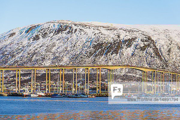 Bridge by snow covered hill in Tromso  Norway