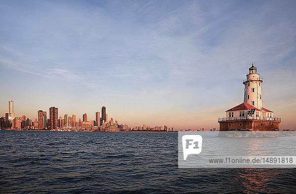 Chicago Harbor Lighthouse at sunrise in Chicago  Illinois  USA