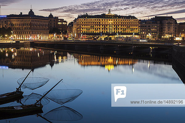 Buildings by river at sunset in Stockholm  Sweden